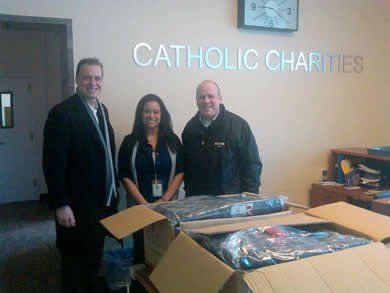 Knights donate Coats for Kids at the Catholic Charities' Kennedy Institute